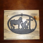 Home Decor - Beetle kill pine wood with a cast iron praying cowboy.